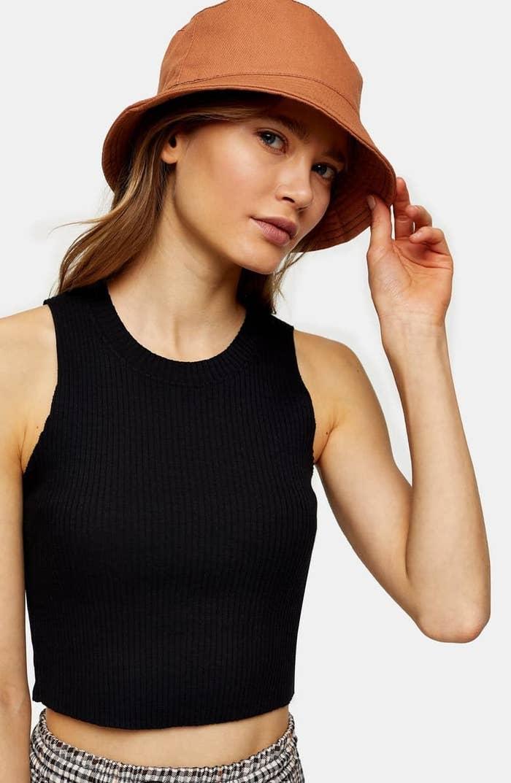 Model wearing black ribbed tank top