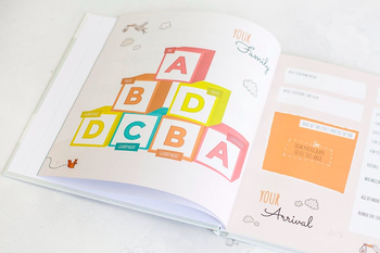An open page of the same book with colorful letter blocks