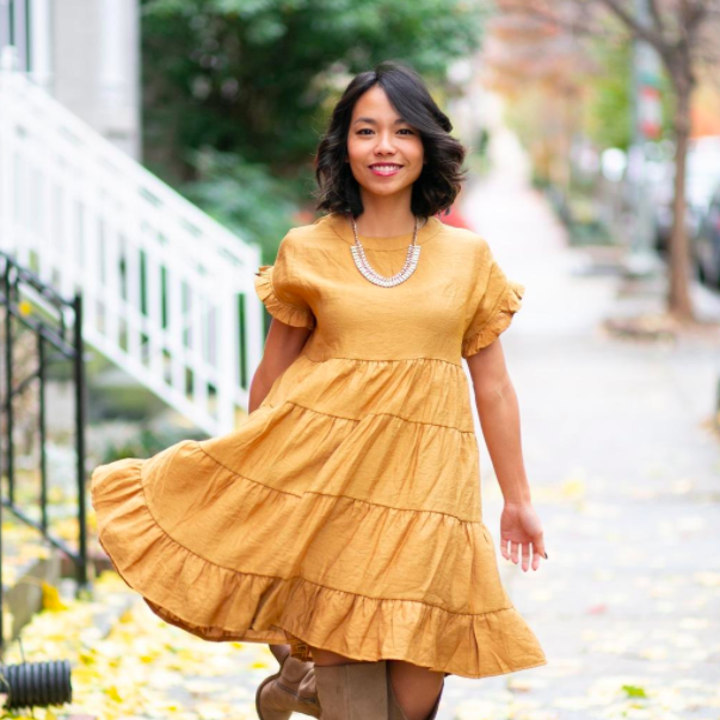 A customer review photo of the baby doll dress in yellow