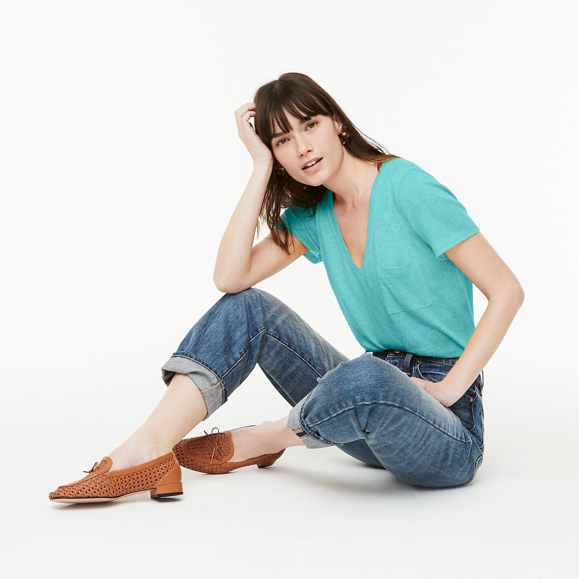 Model wearing the V-neck shirt paired with jeans