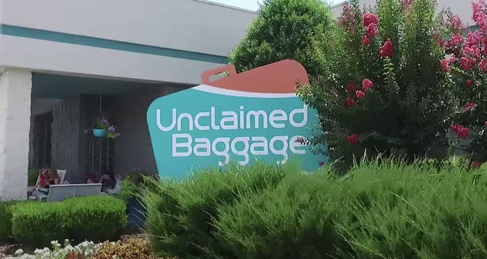 """unclaimed baggage"" shop sign shaped like a suitcase"