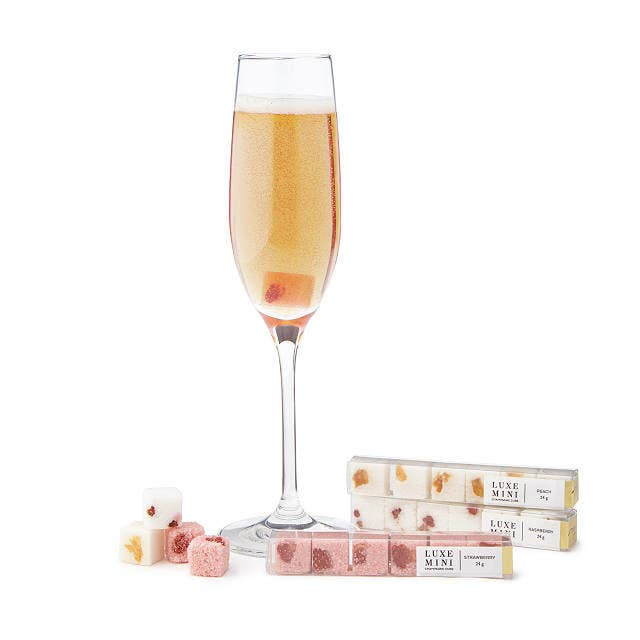 the mimosa sugar cubes along with a glass of mimosa