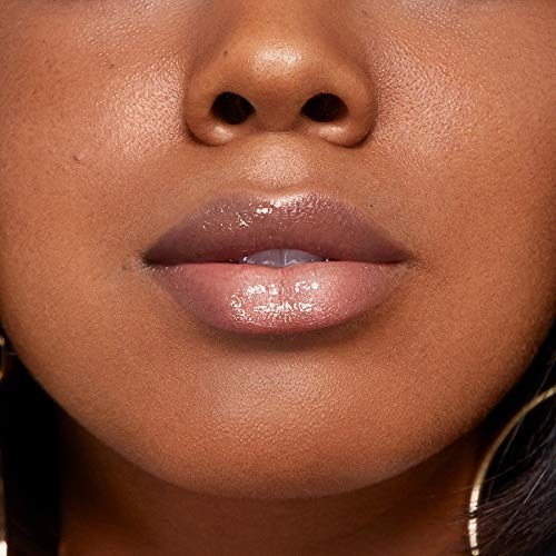 A close up of lips using Rimmel Stay Glossy 6 Hour Lipgloss in Seduce Me