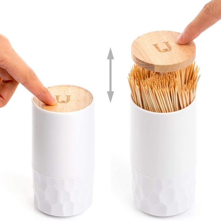 Photo demonstrating that the lid pops up and stays shut with the push of a finger
