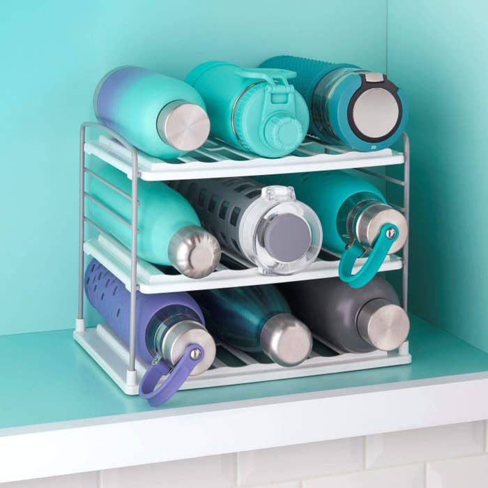 A three-tier version with three water bottles on each shelf