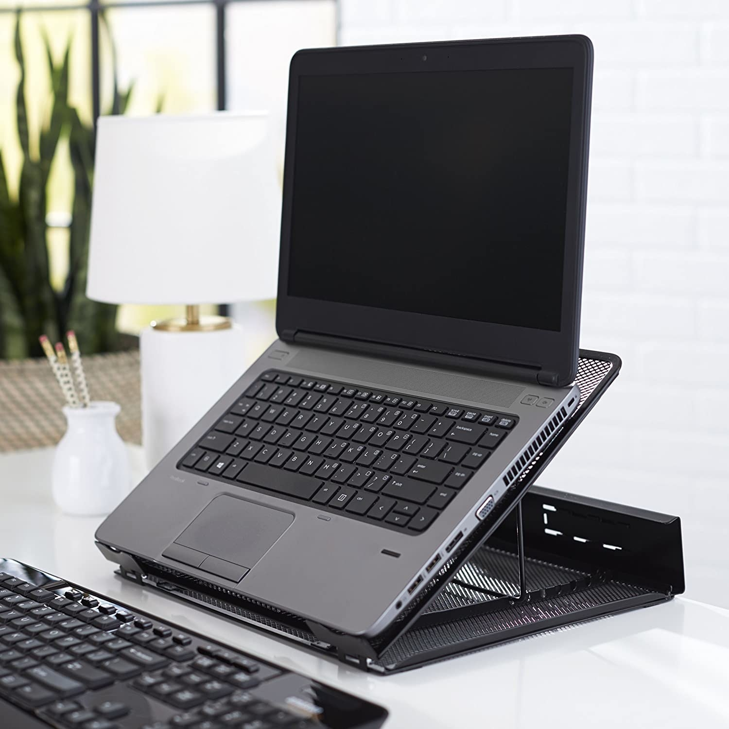 An angled laptop on the laptop stand
