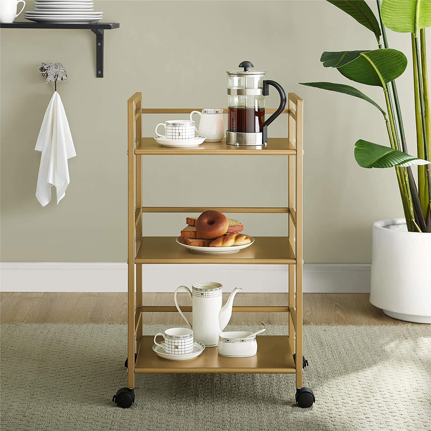 The three-tiered gold shelf with wheels