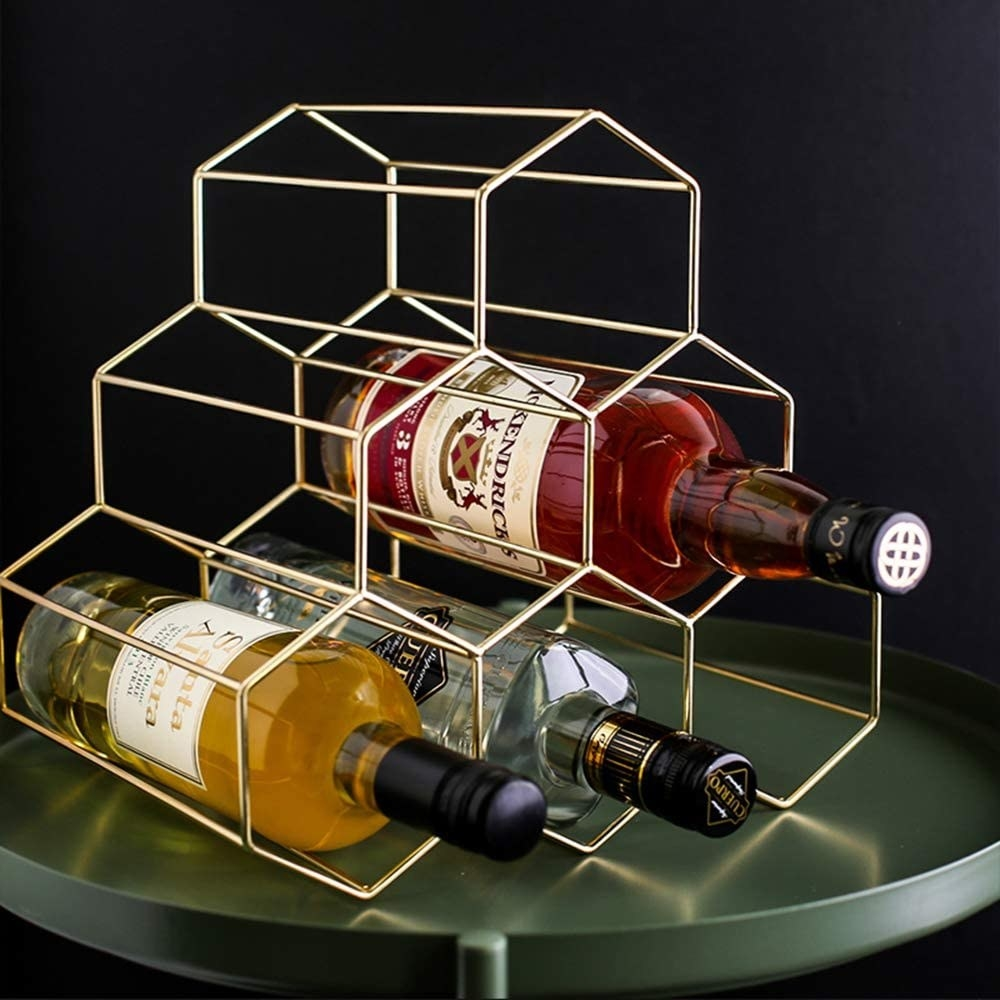 A closeup shot of the honeycomb design, with enough space to hold six bottles of wine