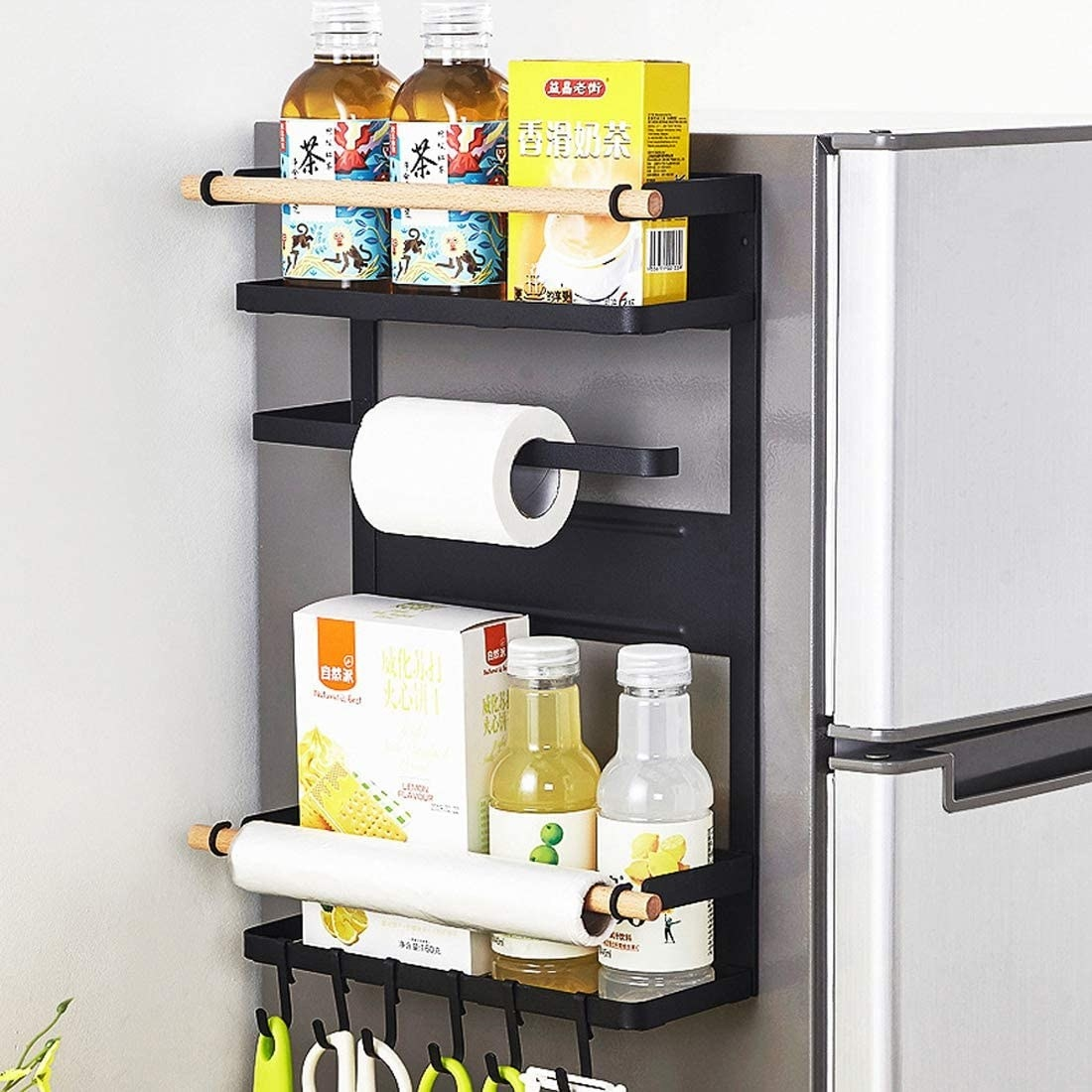 A product shot of the organizer with hooks holding scissors and utensils, three poles for paper towels, and two shelves for storing boxes and bottles of food