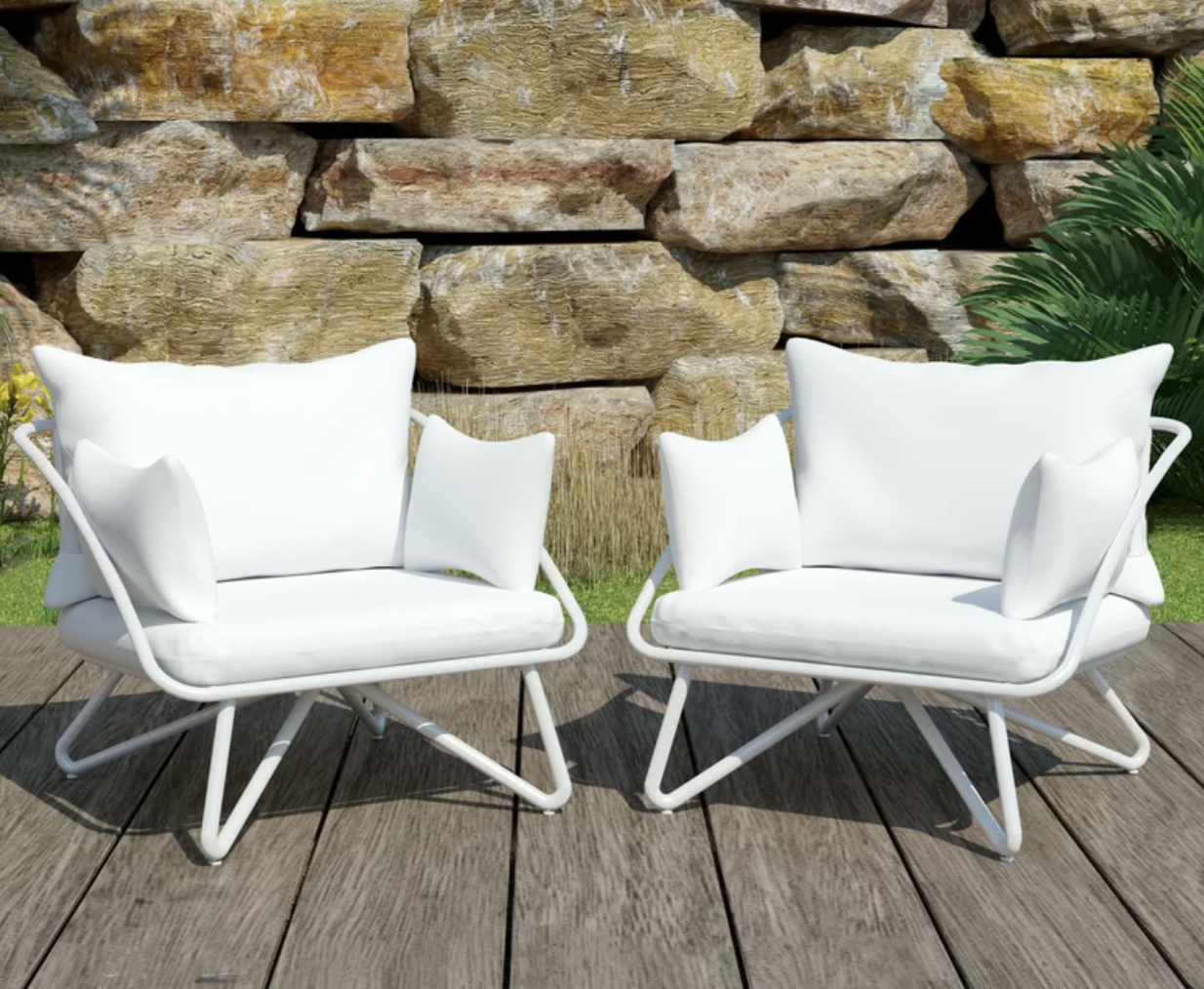 A pair of white patio chairs next to each other on a wooden porch