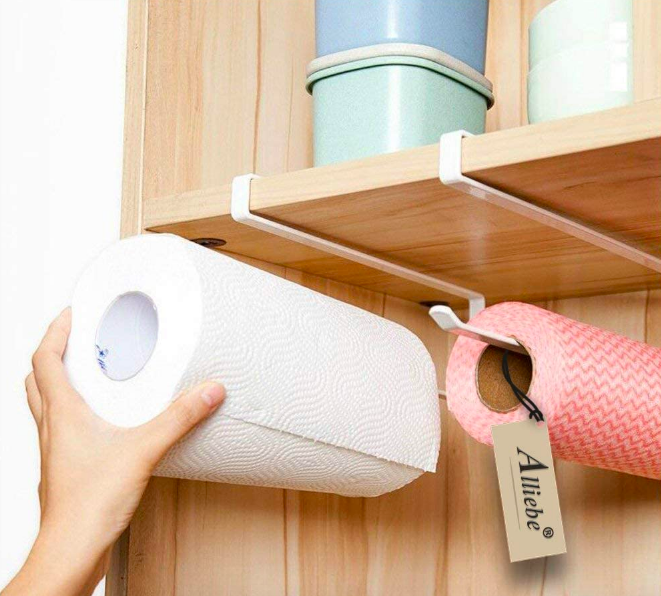 A product shot with the hooks attached to a shelf. One hook holds a large paper towel roll and the other holds a small wrapping paper roll.