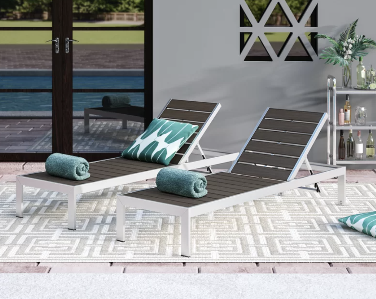 Two brown and white lounge chairs with teal towels on top