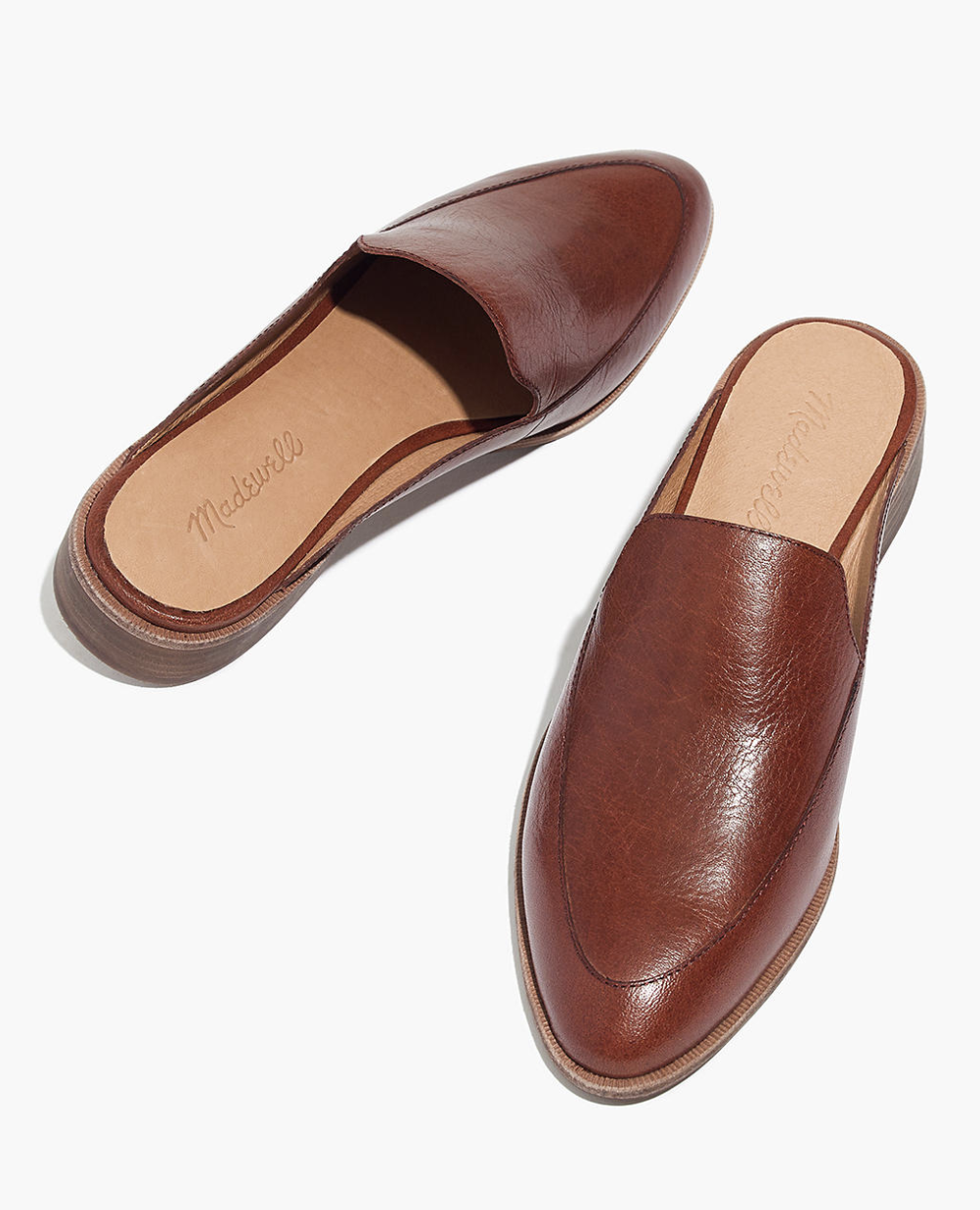 mahogany loafers with an open back and a slightly pointed toe