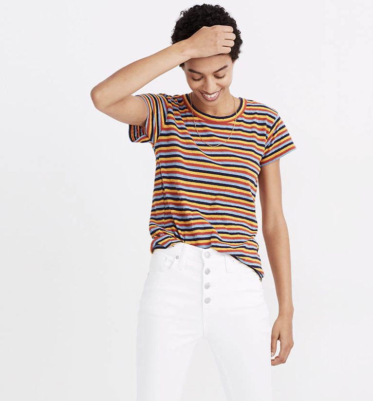 a model in a tshirt with red, light blue, dark blue, and yellow horizontal stripes