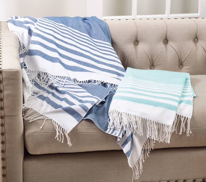the striped blue and white blanket with tassel trim