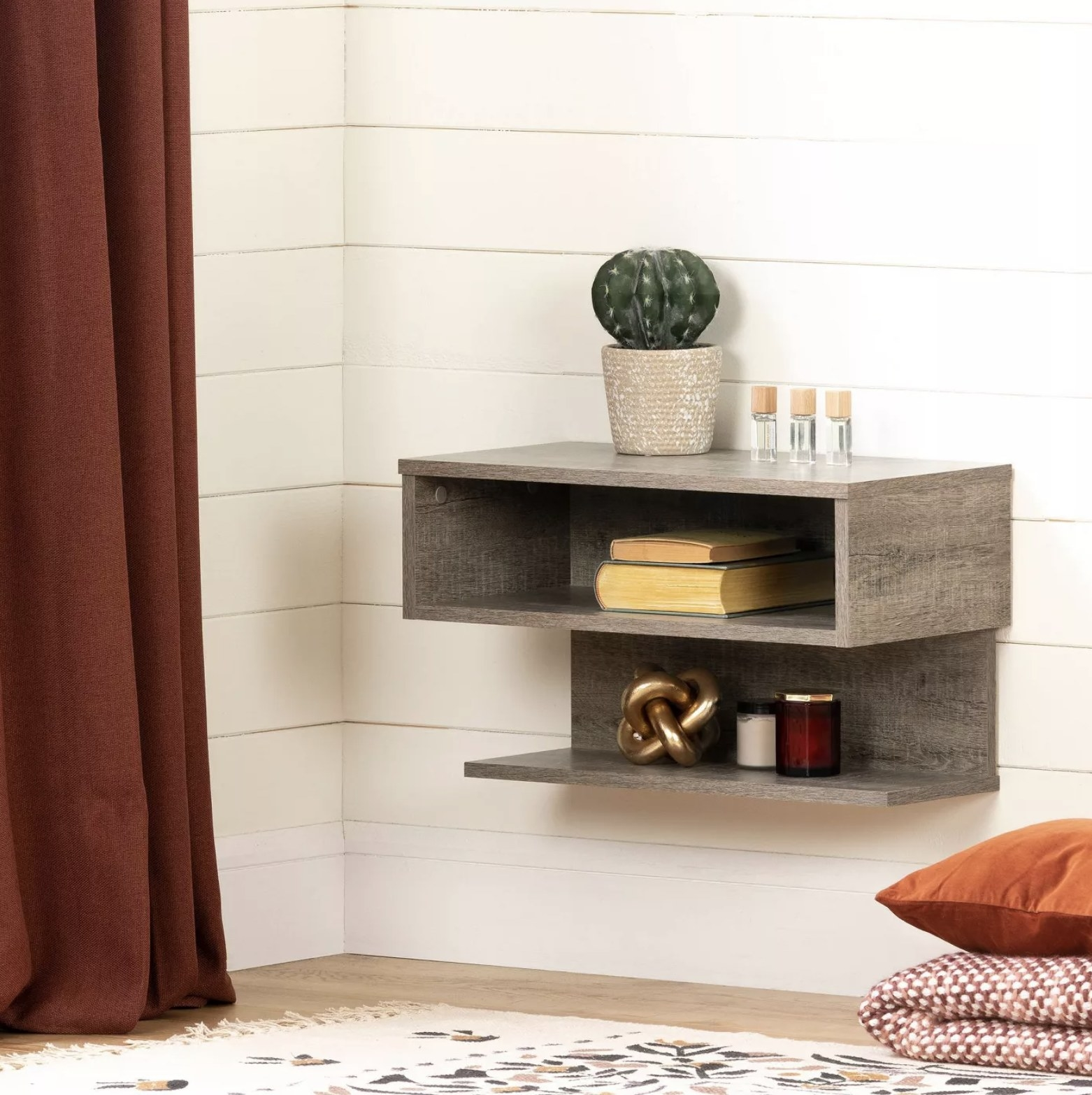 A legless gray nightstand with two shelves that it attached to the wall