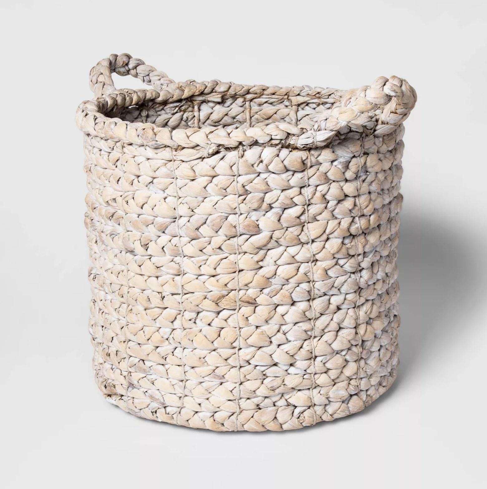 A braided decorative straw basket