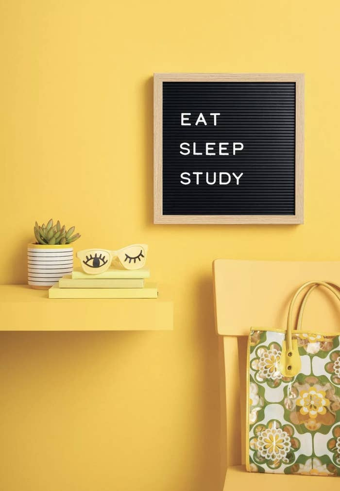 """A black letterboard with the words """"Eat Sleep Study"""" in white"""