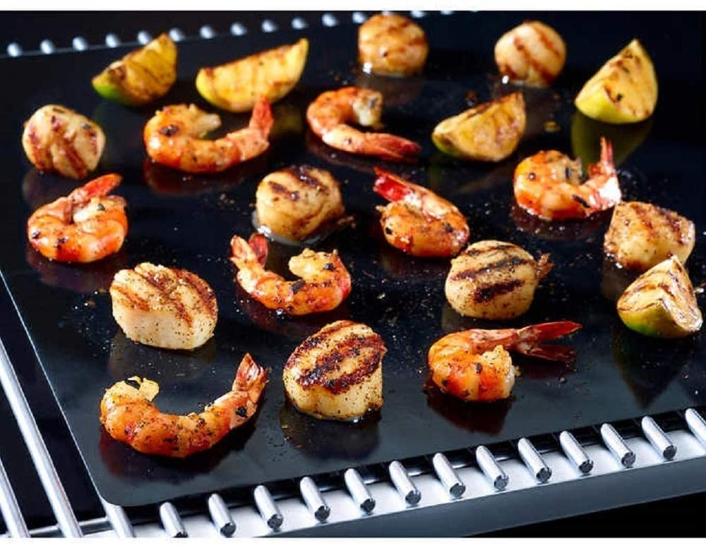 Shrimp and vegetables on a reusable grilling sheet