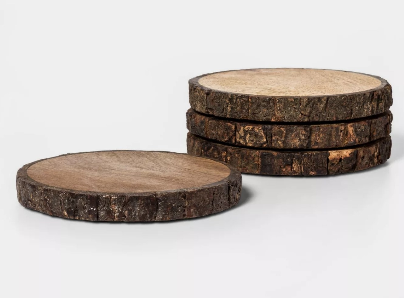 Four coasters that look like they were carved from a tree