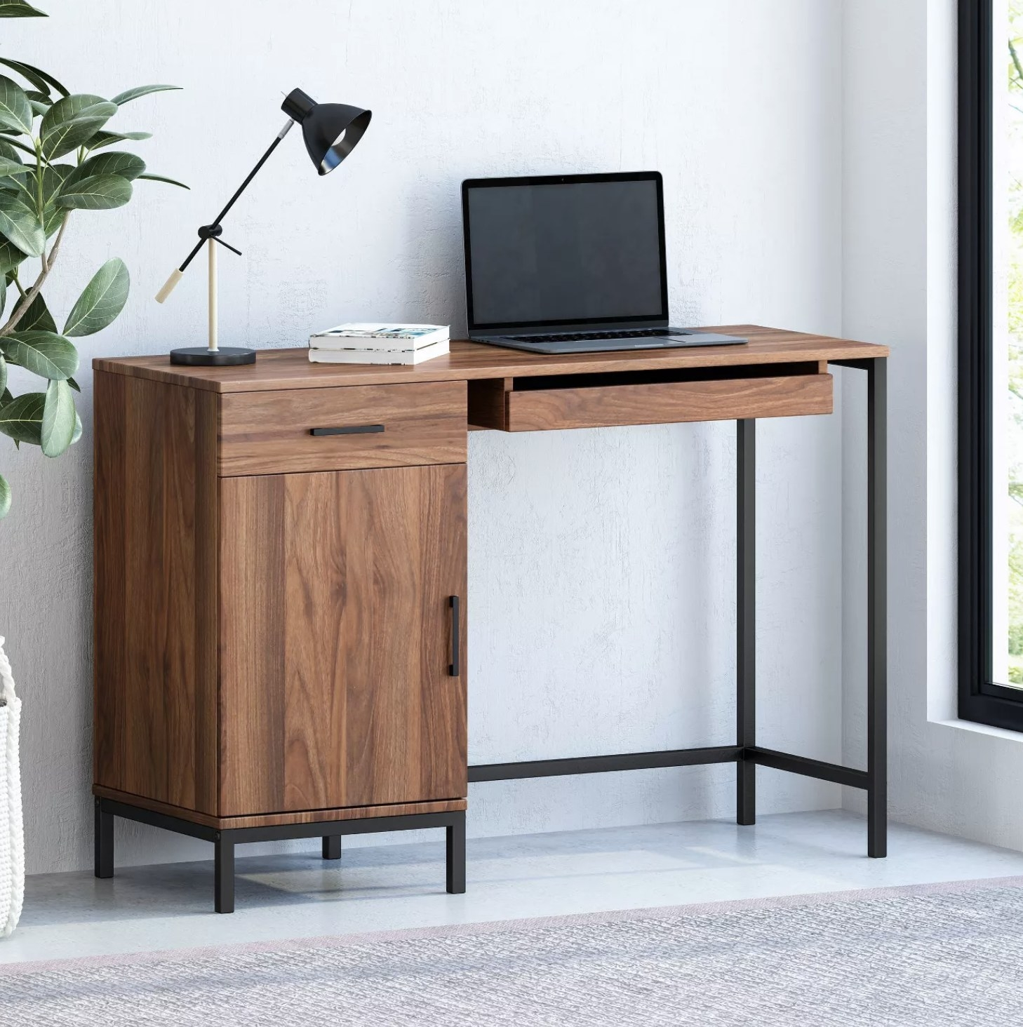 A brown work desk with a side cabinet and two drawers
