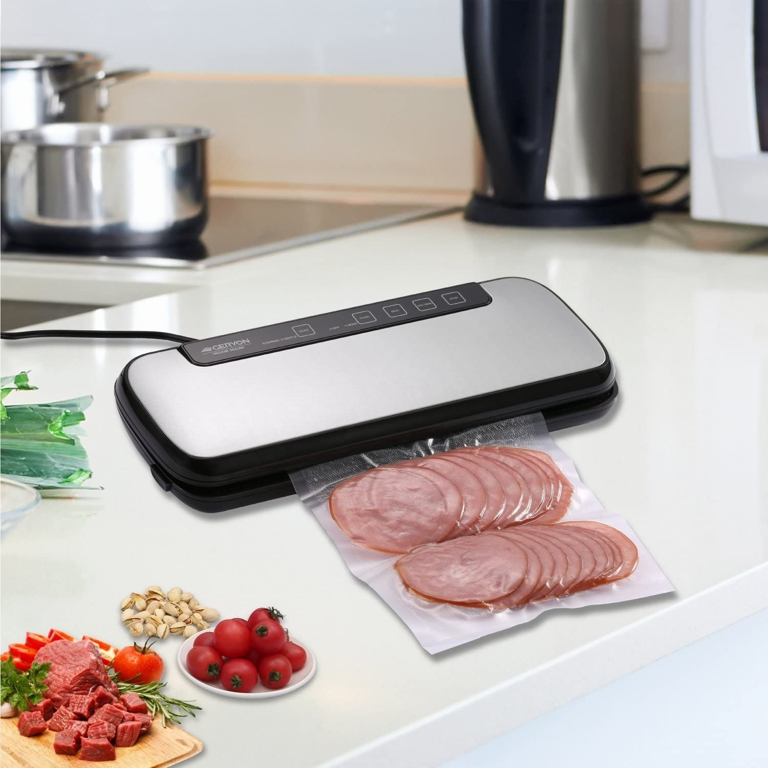 A food-sealing machine next to a pack of vacuum-sealed ham slices.