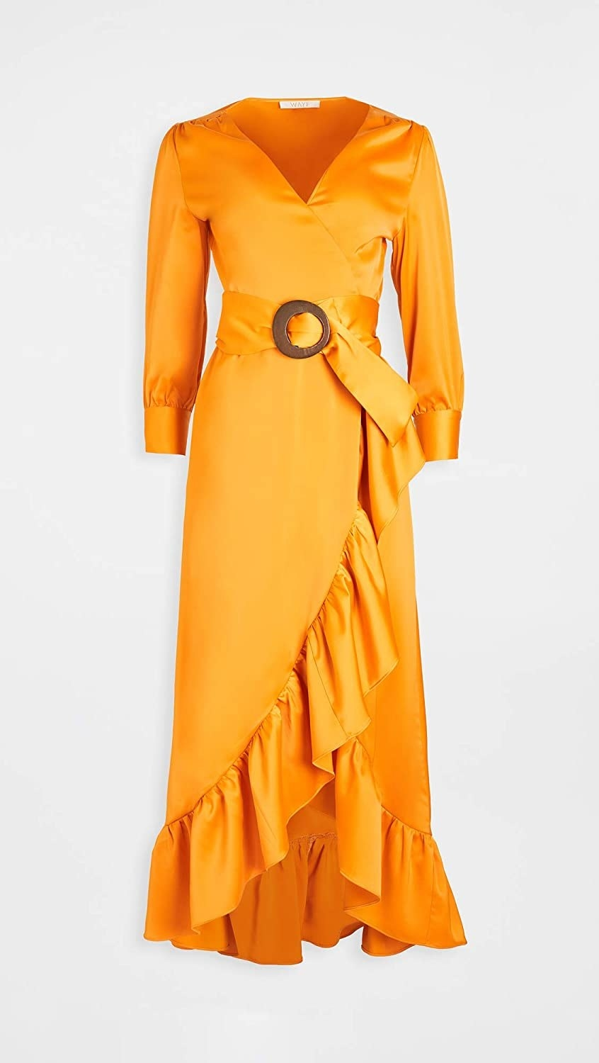 The dress in bright orange with a wrap style and ruffles around the bottom hem, and thick belt with brown wood buckle