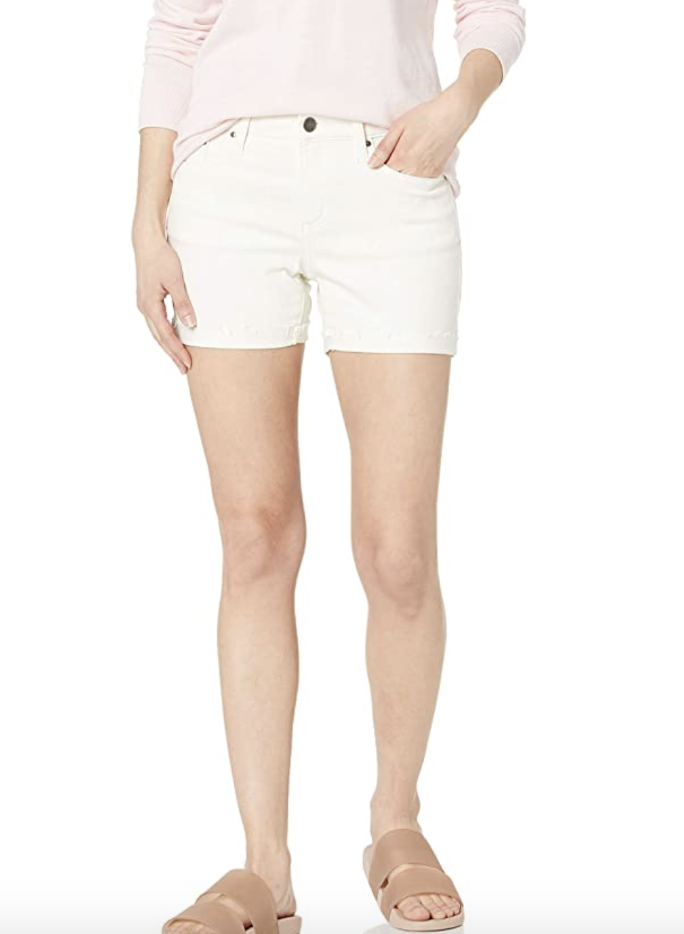 A model in white denim shorts that fall just above mid thigh