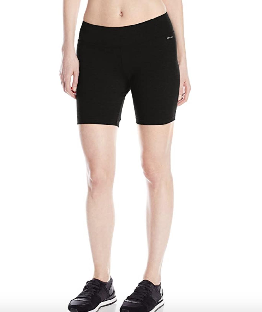 A model in black bike shorts that fall mid thigh