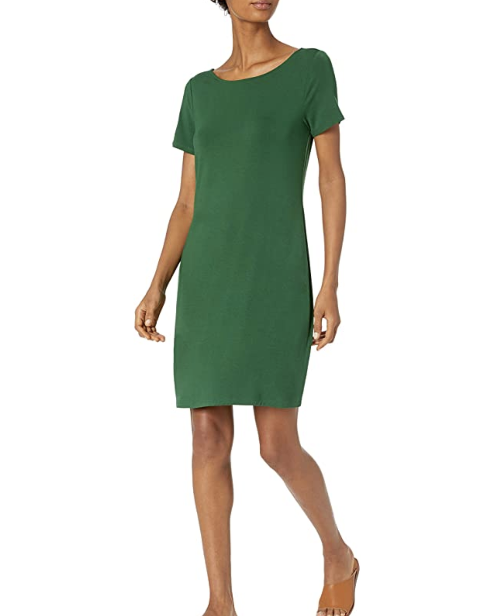 A model in a green t-shirt dress with a scoop neckline that falls just above the knee