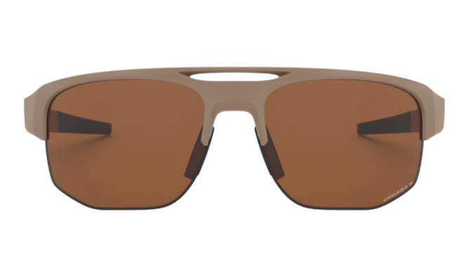 A pair of squared sunglasses with matte top frames sit on a plain background