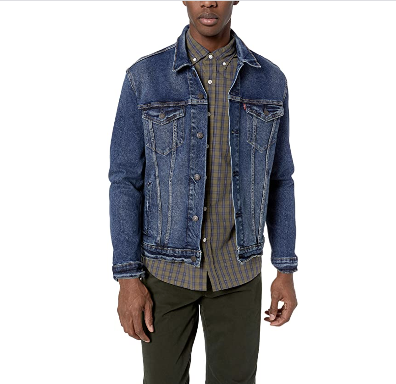 Model wearing denim jacket with pockets with a button flap close on both sides of the chest and buttons down the front in a classic blue color