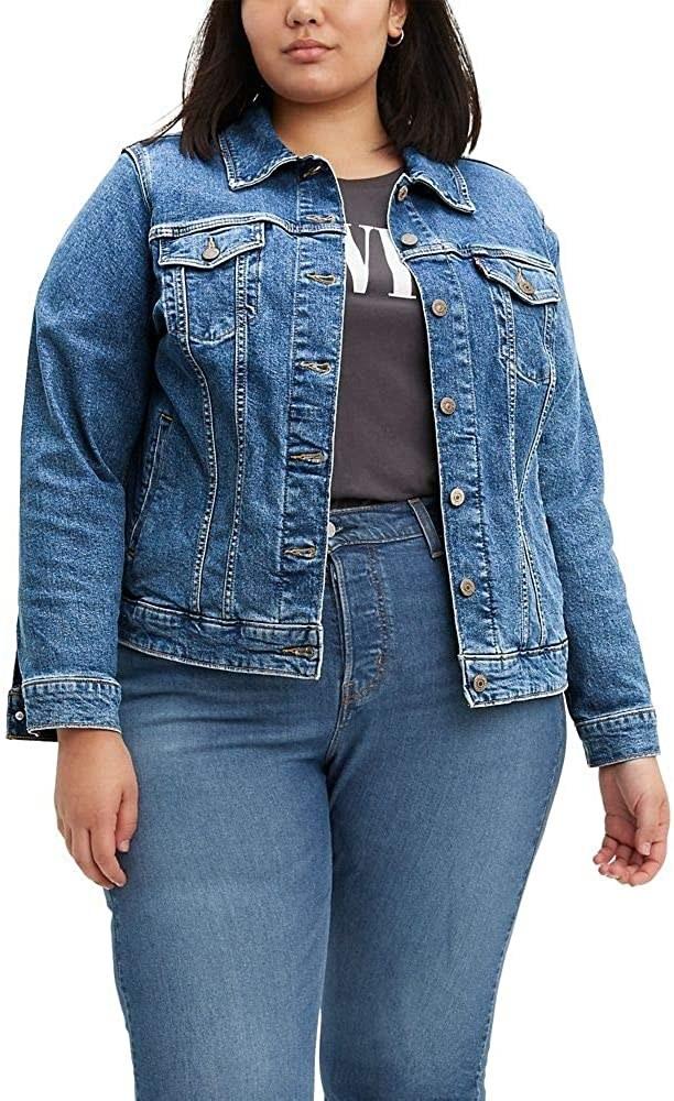 Model wearing a medium wash denim jacket