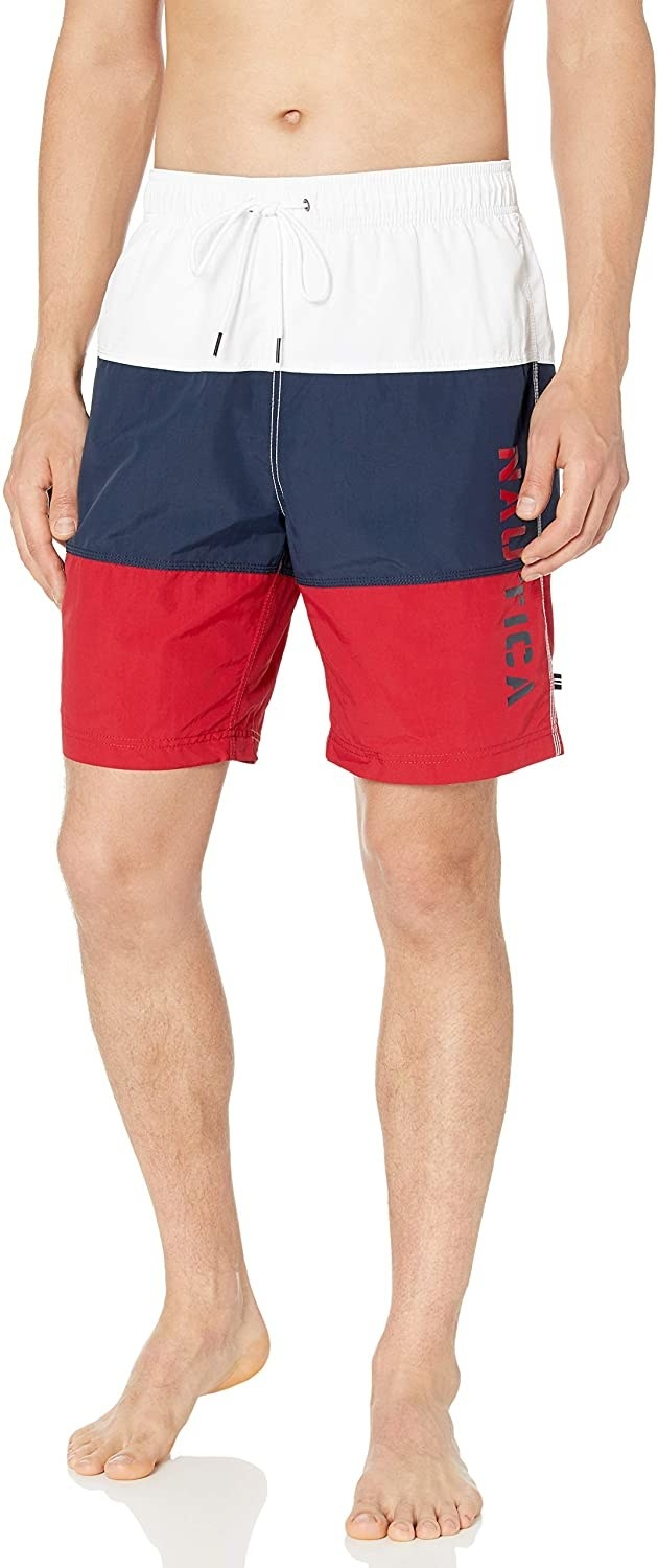 Model in the red white and blue trunks
