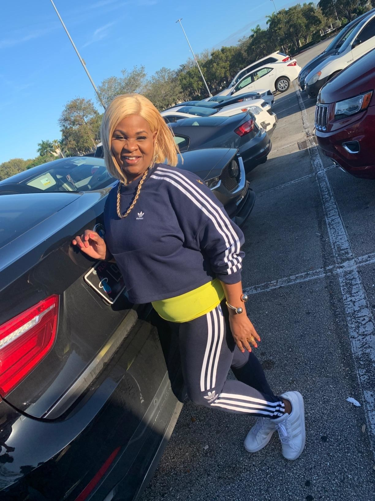 Reviewer wearing the navy leggings with matching sweatshirt