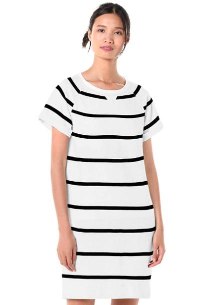 Model wears a white and black striped sweatshirt dress