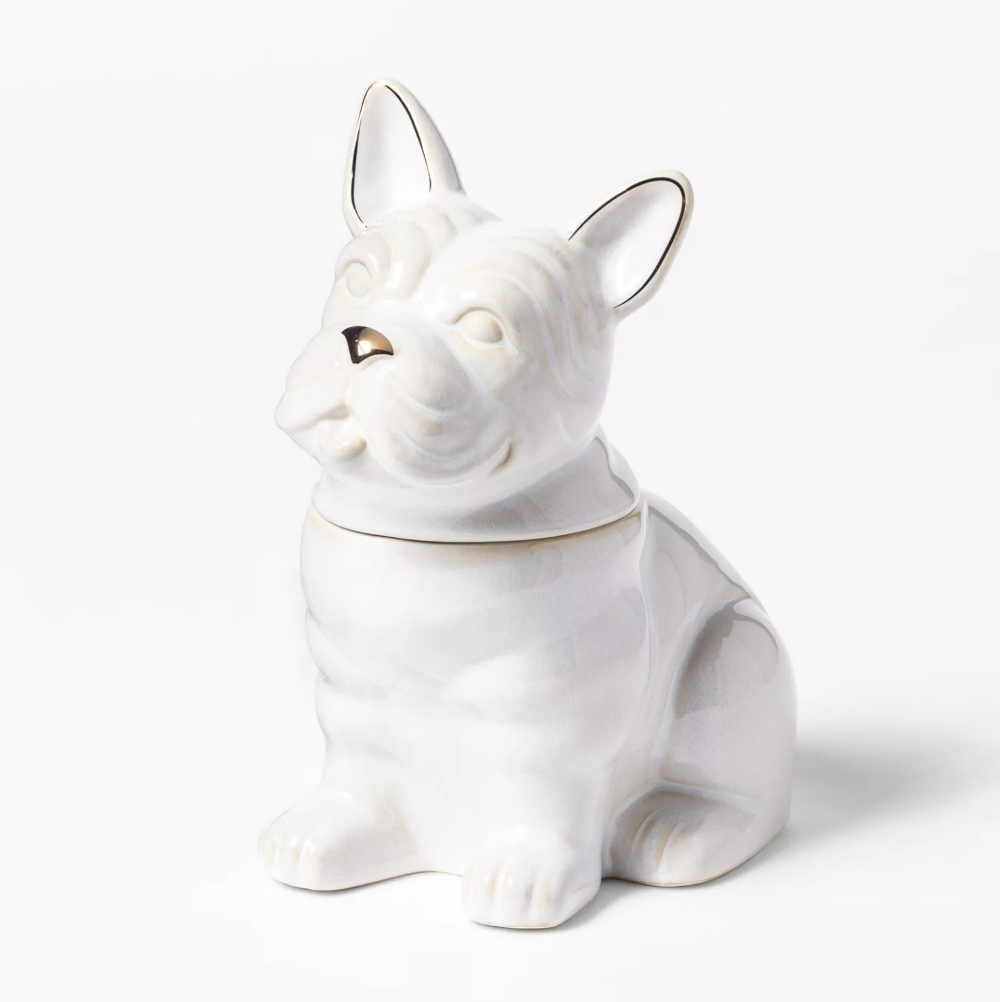 A white ceramic bulldog-shaped cookie jar with gold accents