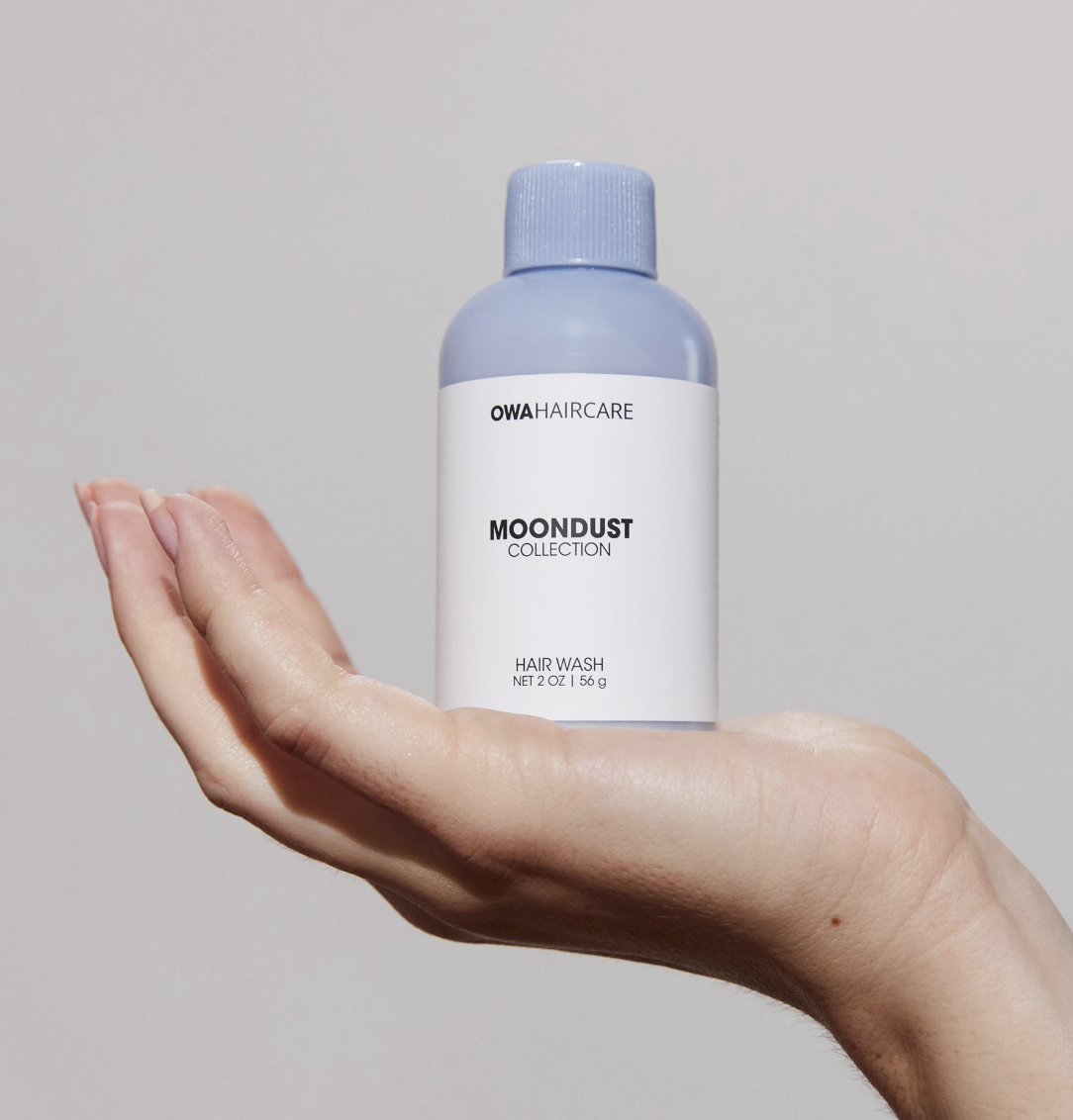 a model's hand holding the bottle of Moondust