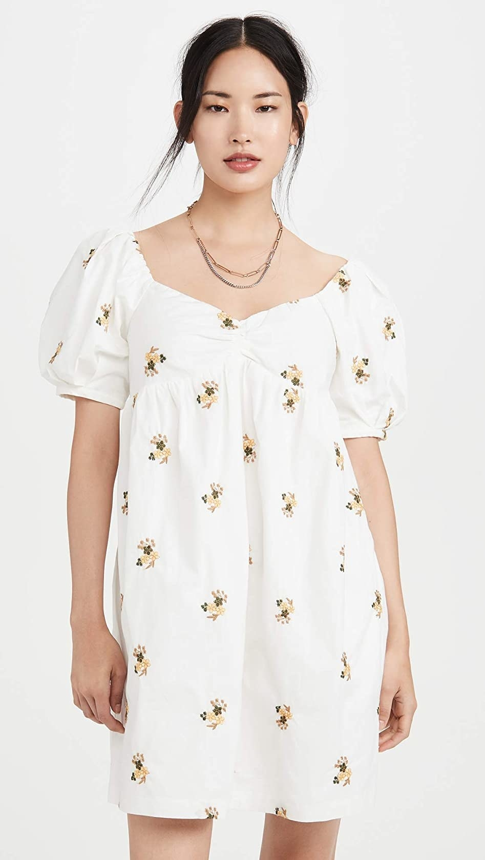 The white and yellow floral dress with puffed short sleeves
