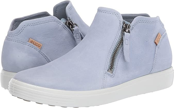 A pair of low-cut booties with a zip by the ankle