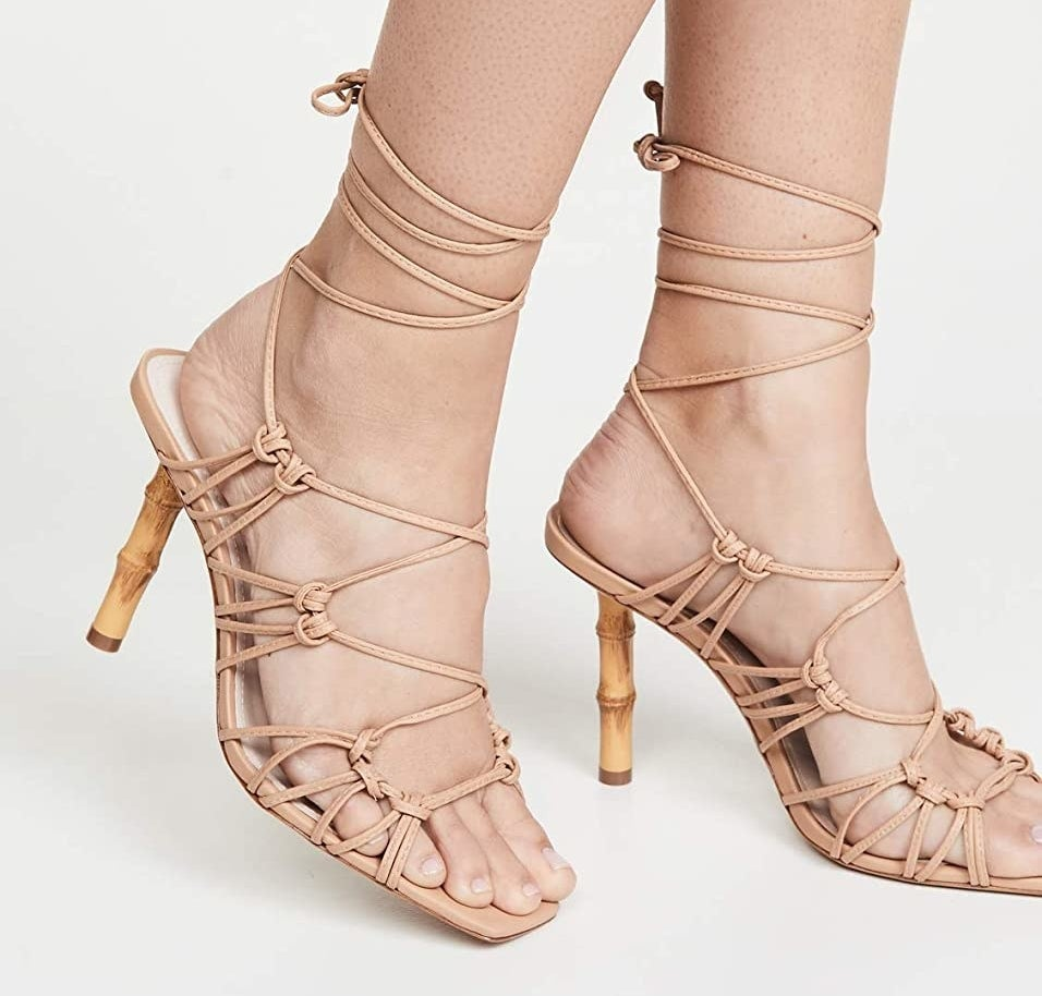 The wooden high heeled sandals with tan leather straps