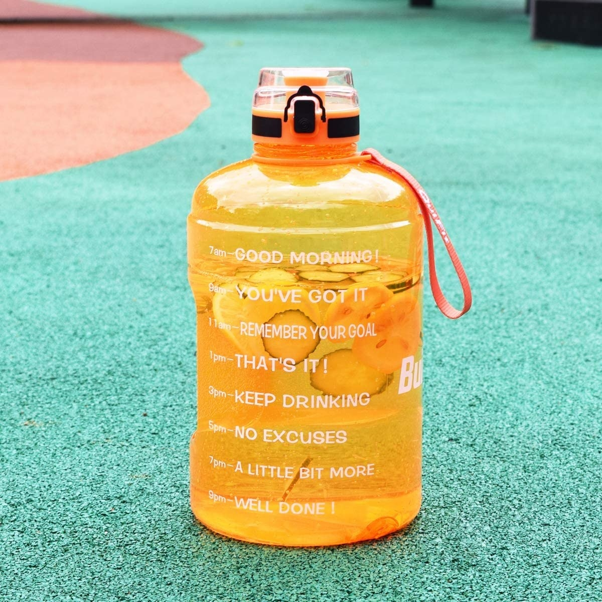 A waterbottle on a track with fruit and water inside