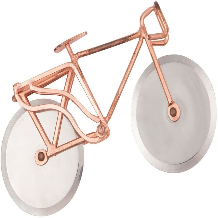 a rose gold bicycle with pizza cutting blades for wheels