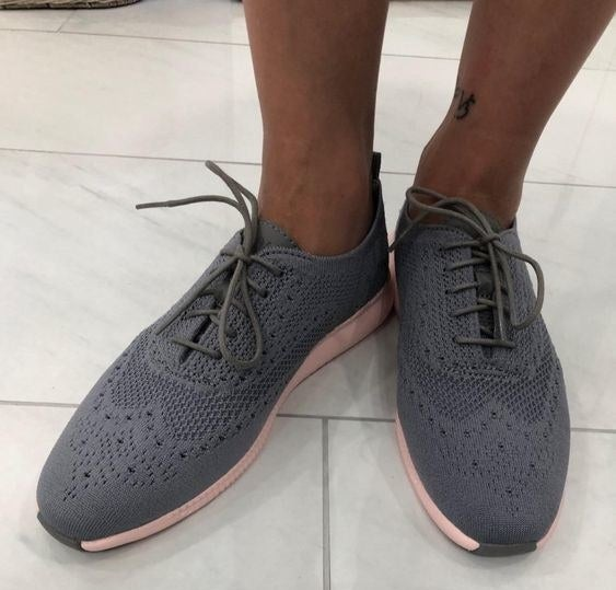 Reviewer's picture of the knit grey and pink sneakers