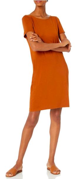 Model wears orange jersey T-shirt dress with sandals