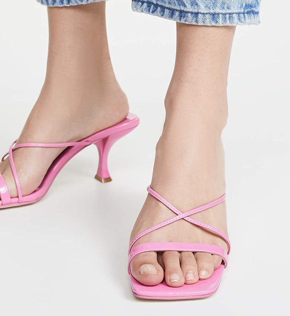 The kitten heeled pink sandals with criss-cross straps