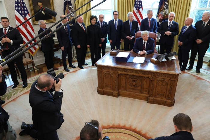 President Donald Trump signs the CARES Act on March 27, 2020, at the White House.