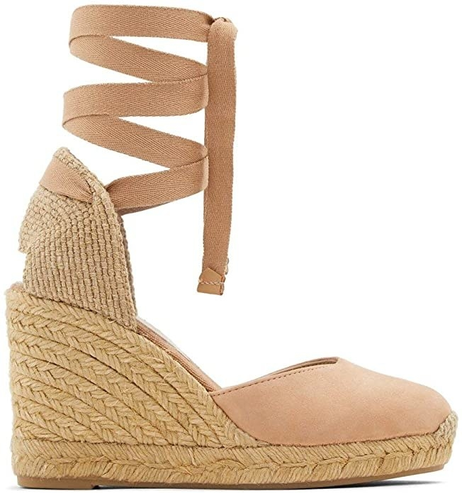 An espadrille with a wedge heel and a platform with a lace-up detail round the ankle