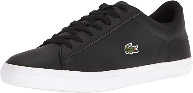 A low top sneaker with a crocodile logo and a different colour sole