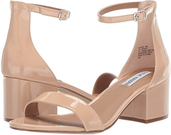 A pair of sandals with a block heel and an ankle closure